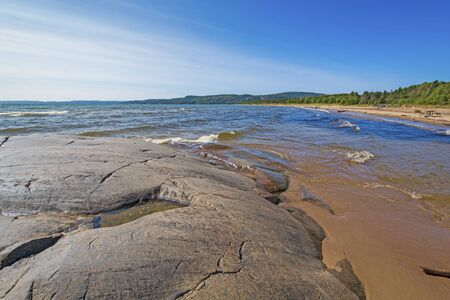 Polished Rocks and Sand on a Remote Shore of Lake Superior in Neys Provincial Park in Ontario