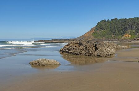 Tidal Reflections on the Coastal Headlands at the Strawberry Hill Beach on the Oregon Coast