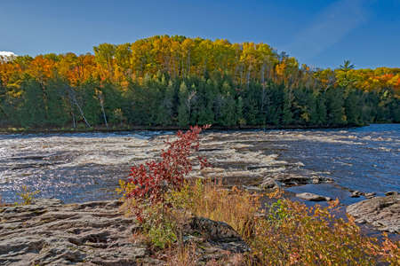 Rocky Rapids in the Menominee River in the North Woods Autumn of Northern Michigan