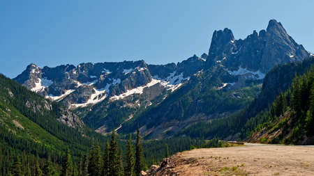 liberty bell: Summer view of Washington Pass with Liberty Bell Mountain and surrounding rocky slopes and evergreen trees