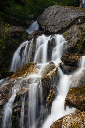 large rocks: Waterfalls flowing over large rocks in natural setting Stock Photo