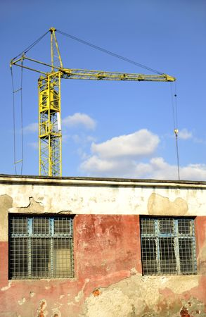 yellow crane and building Stock Photo