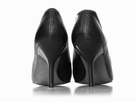 black leather woman shoes with high heels photographed from the back