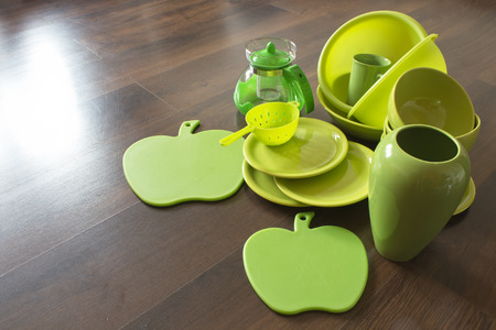 green porcelain dishes on a dark wooden parquet Stock Photo