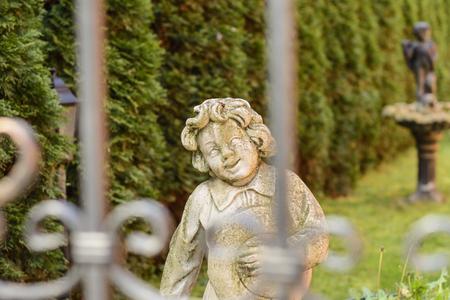 Enter the garden! Springtime sunlight made this statue come alive... Stock Photo