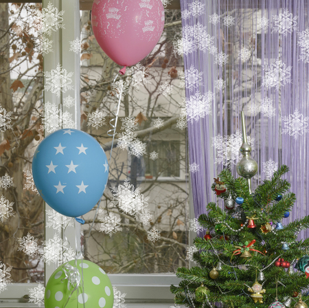 Winter birthday! Christmas tree with balloons beside it. Through the window, there are naked branches of the Platanus tree and part of a building. Snowflakes added in post processing.