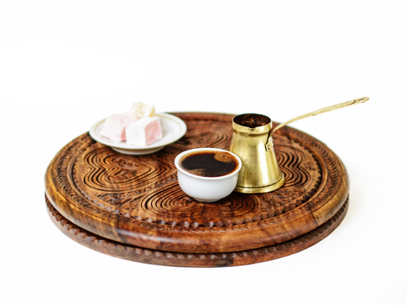 Turkish coffee served  in a traditional manner in a fildzan. It was made in the brass cezve and served with a few cubes of rahat lokum as a sweet snack.