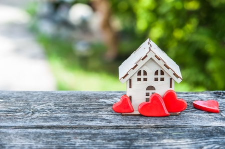 seller: A toy house with a fence of hearts. A symbol of a house where love reigns. Theme of happiness, warmth, good luck, love, construction, travel, hotel business, family