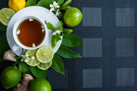White cup with tea. Green, black, herbal, jasmine tea with lemon and ginger.Background with space for text. Tea theme. Stok Fotoğraf