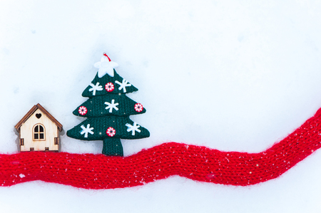 Toy house with a Christmas tree in the snow., a deer space for text. Christmas, New Year congratulations.   Stock Photo