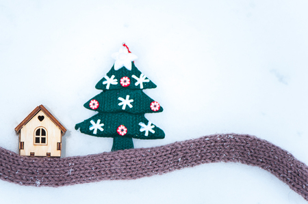 Toy house with a Christmas tree in the snow.,  space for text. Christmas, New Year congratulations.   Stock Photo
