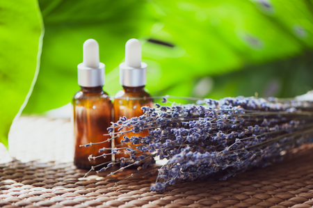 Oil, whey, cream with lavender. Organic cosmetics. A bouquet of lavender and jars on the background Stock Photo