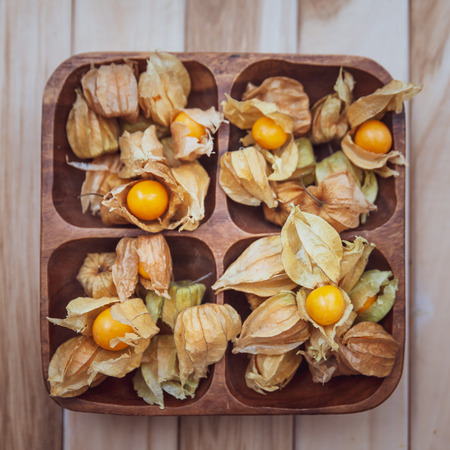 Physalis , golden gooseberry on wooden background,  flat lay