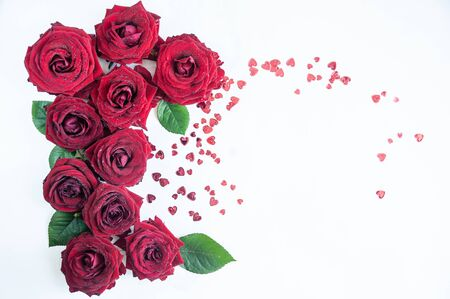 Flat Lay Background, flower pattern, Valentines Day, the theme of lovers. Red roses on a white background, isolated. Space for texr