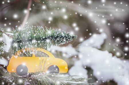 Stylish wooden car with a Christmas tree on a natural  background, space for text Imagens