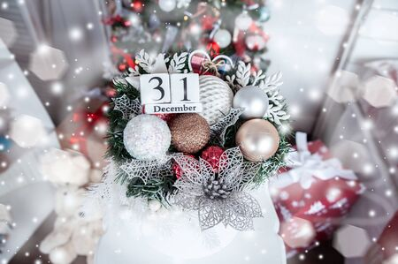 Wooden calendar with on the background of a Christmas tree with a date of December 31, a symbol of the new year