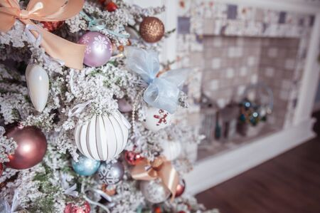 White decorated Christmas tree close-up, space for text, New Year mood, delicate pastel colors