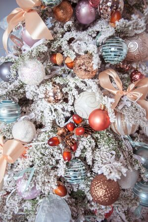 White decorated Christmas tree close-up, New Year mood