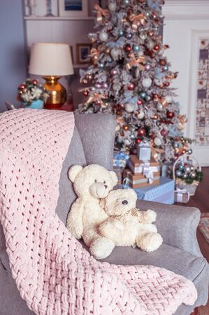 Room decorated for the new year, in soft pastel colors, cute bears in an armchair. Christmas mood Stok Fotoğraf