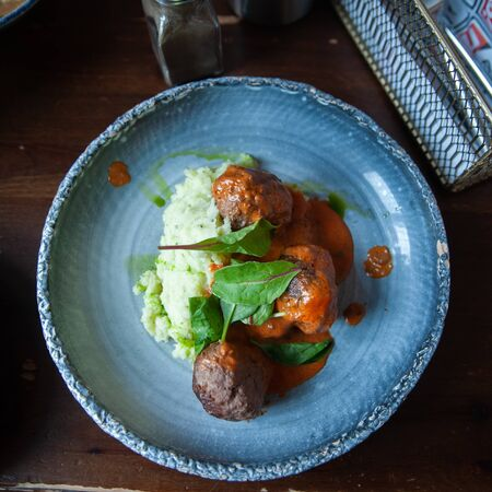 Meatballs with sauce and mashed potatoes, rustic style