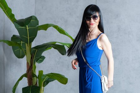 Expressive and glamorous beautiful  girl in a blue dress and sunglasses. Trendy  fashion  summer  and spring concept. Banque d'images - 147066238