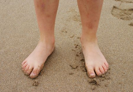 young leave: Feet in Sand Stock Photo