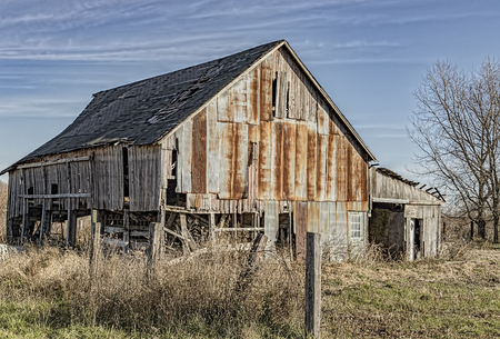 Decaying and rusting barn.