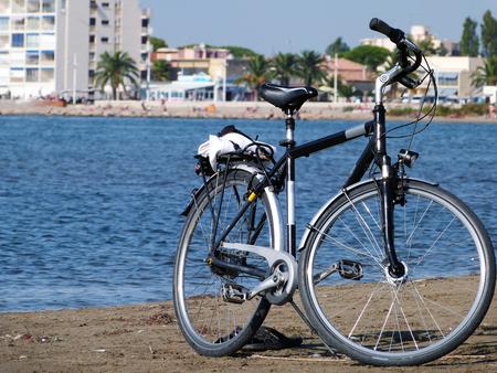 beachfront: Bicycle to the beach Stock Photo