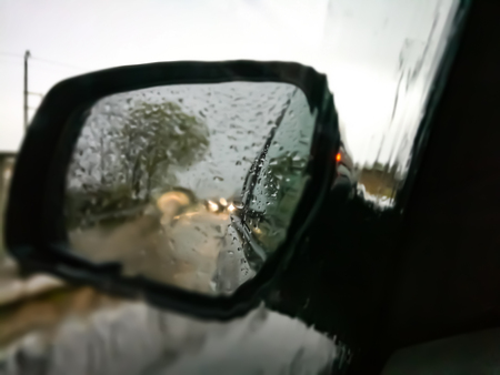 Rear view mirror in the rain