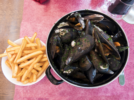 Dish of mussels with french fries 写真素材