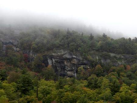 Mountain in autumn under the mist