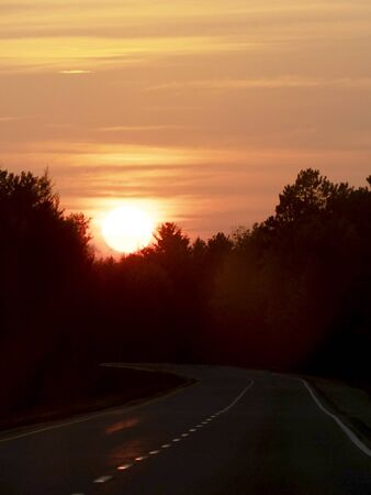 Sunset on the road in autumn
