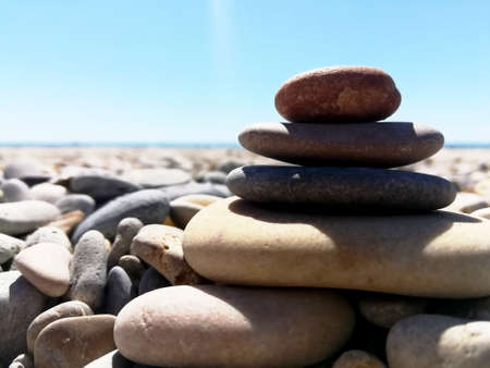Pebbles stacked on the beach Stockfoto
