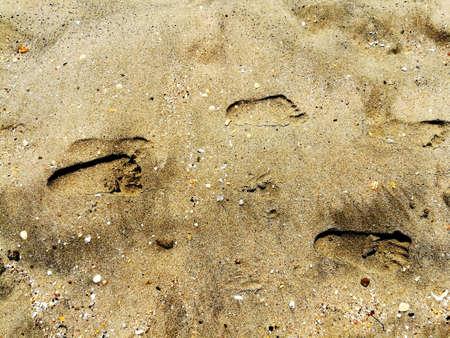 Footprint on the warm sand of the beach Reklamní fotografie - 156329096