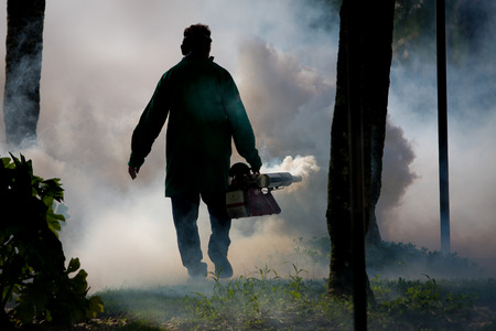 A man fumigates for mosquitoes