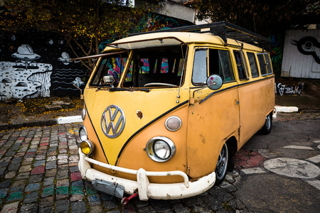 panel van: Sao Paulo, Brazil - July 5. Volkswagen Kombi old in Batmans Alley. Beco do Batman is the nickname for the Vila Madalena neighborhood of So Paulo. Beco do Batman is a popular tourist destination because of the dense concentration of graffiti que line the  Editorial