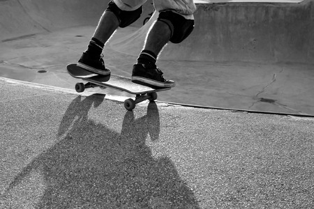 kneepad: Skateboarder in a bowl of a skate park Stock Photo