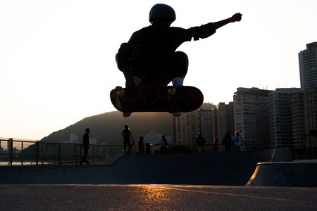 kneepad: skateboarder jumping in a bowl of a skate park Stock Photo