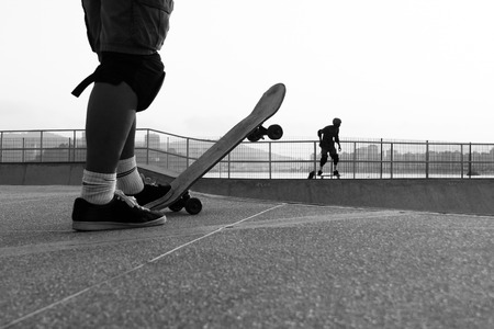kneepad: Boys playing in a skate park