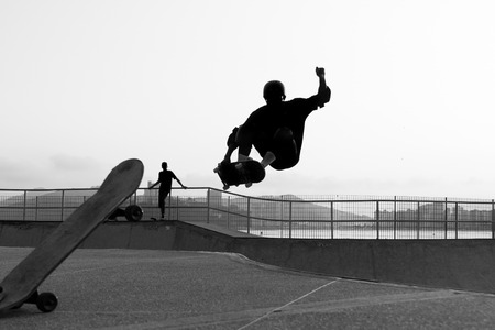 adolescent: skateboarder jumping in a bowl of a skate park Stock Photo