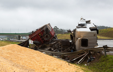total loss: Truck accident laden with corn in bulk Editorial