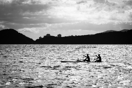 outrigger: Double paddling on a outrigger canoe