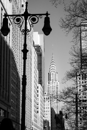 New York, USA, April 13, 2016. Old lamp post with the Chrysler Building in the background