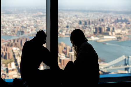 window view: Couple admiring the view of One World Trade Center