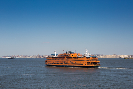staten: Staten Island, New York, April 13, 2015. The Staten Island Ferry is a passenger ferry service operated by the New York City Department of Transportation. It runs 5 miles (8.0 km) in New York Harbor between the New York City boroughs of Manhattan and State