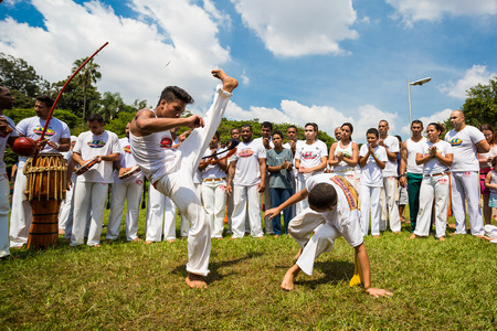 Saoo Paulo, Brazil, 03 April 2016. Group of Brazilian capoeiristas performing at the Ibirapuera Park in Sao Paulo, Brazil. Editorial