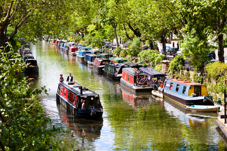 London, England. May 25, 2014. Tourists strolling by boat in Little Venice, Regent's Canal, London, England Editorial