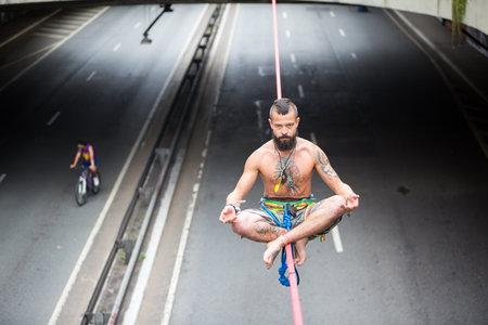 Sao Paulo, Brazil. February 25, 2018. The slackliner, Leandro, usually practices every Sunday at Avenida Paulista, in Sao Paulo.