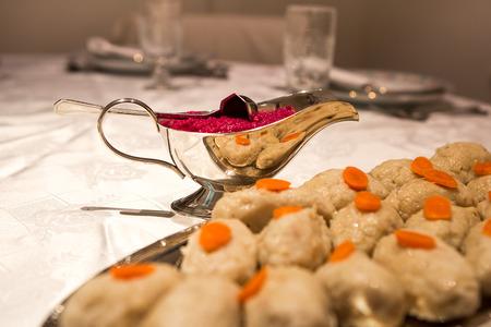 Traditional Jewish passover food gefilte fish Фото со стока