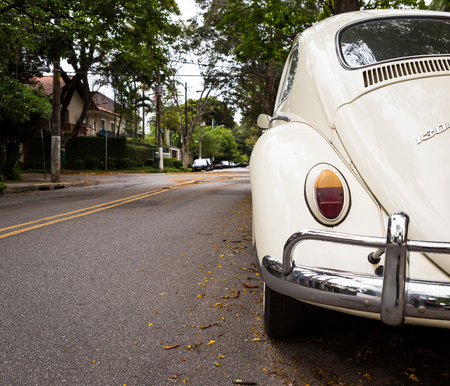 Sao Paulo, Brazil. October 23,2018. Original 1961 white Volkswagen Beetle parked in front of residence